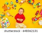baby  lying on yellow... | Shutterstock . vector #648362131