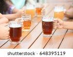people drinking beer in cafe   Shutterstock . vector #648395119