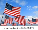 waving usa flags on sky... | Shutterstock . vector #648433177