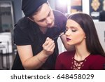 male in the black hat make up... | Shutterstock . vector #648458029
