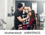 cool male make up artist doing... | Shutterstock . vector #648459631