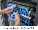 hand of system administrator... | Shutterstock . vector #648476824