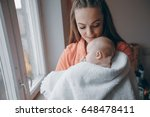 young family at home caring for ... | Shutterstock . vector #648478411