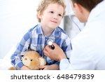 doctor examining a child ... | Shutterstock . vector #648479839