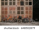 many bicycles in a row on the... | Shutterstock . vector #648502879