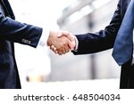 business partnership meeting... | Shutterstock . vector #648504034