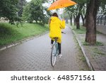 bicycle ride in the rain. woman ...   Shutterstock . vector #648571561