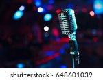 retro microphone against blur... | Shutterstock . vector #648601039