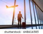 businessman with suitcase at... | Shutterstock . vector #648616585