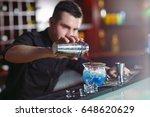 bartender pouring fresh... | Shutterstock . vector #648620629