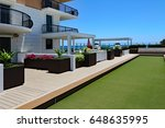 inviting rooftop bocce ball... | Shutterstock . vector #648635995