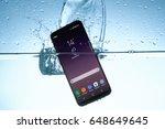 galaxy s8 in water | Shutterstock . vector #648649645