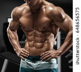 muscular man abs in gym  shaped ... | Shutterstock . vector #648656575