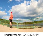 rear view to inline skater in... | Shutterstock . vector #648660049