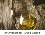 wine. glass of white wine in... | Shutterstock . vector #648665095