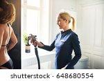 Cosmetologist Using Aerograph...
