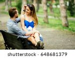 dating couple sitting on bench | Shutterstock . vector #648681379