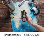 man holding a compass over a... | Shutterstock . vector #648702121