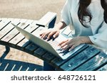 young woman using laptop... | Shutterstock . vector #648726121
