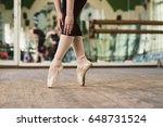 ballerina standing on toes.... | Shutterstock . vector #648731524