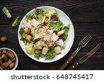 fresh caesar salad in white... | Shutterstock . vector #648745417