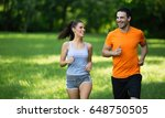 happy couple running and... | Shutterstock . vector #648750505
