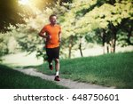 Active healthy runner jogging...