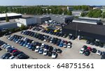 Aerial photo of small temporary car lot to store new cars for resale and car dealers who do not have free space for storage - stock photo