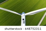 Small photo of Aerial photo of wind turbine close above unit blades sideways mill located on grassland top down view looking down on large white windmill aerofoil powered windmills providing sustainable energy
