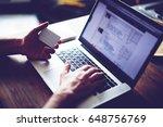 cropped shot of a man's hands... | Shutterstock . vector #648756769
