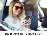 beautiful girl in the backseat... | Shutterstock . vector #648785707