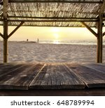 empty bar table against sunset... | Shutterstock . vector #648789994