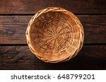 Empty Wicker Basket On A Woode...