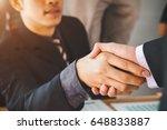 business handshake and business ... | Shutterstock . vector #648833887