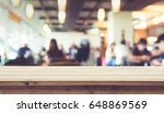 wood table top with blur of... | Shutterstock . vector #648869569