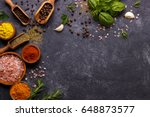 spices and herbs over black... | Shutterstock . vector #648873577