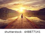 hiker walking along the road to ... | Shutterstock . vector #648877141