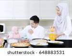 smiling family eating together... | Shutterstock . vector #648883531