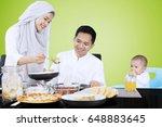 muslim female serves food for... | Shutterstock . vector #648883645