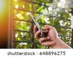 hand holding mobile smart phone ... | Shutterstock . vector #648896275