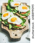 healthy breakfast sandwiches.... | Shutterstock . vector #648899095