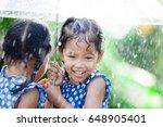 Two Happy Asian Little Girls...