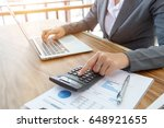 business women press calculator ... | Shutterstock . vector #648921655