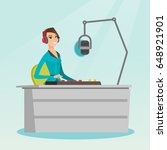 young dj working in front of... | Shutterstock .eps vector #648921901
