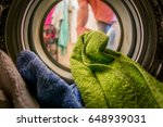 man putting color clothes into... | Shutterstock . vector #648939031