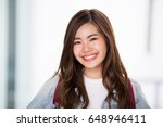 young asian girl smiling | Shutterstock . vector #648946411