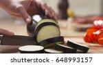 female teen hands slicing... | Shutterstock . vector #648993157