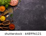 spices and herbs over black... | Shutterstock . vector #648996121
