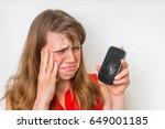 Sad Woman Is Holding Smartphon...