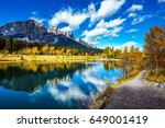 the path and yellowing aspens... | Shutterstock . vector #649001419